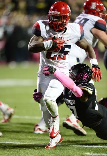 Oct 26, 2013; Boulder, CO, USA; Arizona Wildcats running back Ka'Deem Carey (25) rushes for a touchdown in the second quarter against the Colorado Buffaloes at Folsom Field. Mandatory Credit: Ron Chenoy-USA TODAY Sports