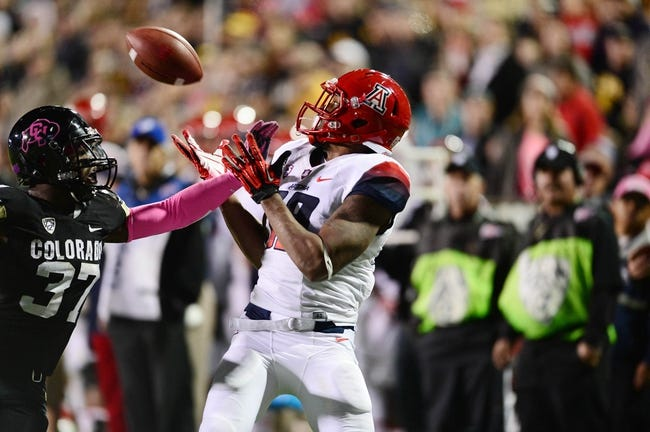 Oct 26, 2013; Boulder, CO, USA; Arizona Wildcats wide receiver Terrence Miller (18) prepares to catch a twenty two yard reception as Colorado Buffaloes linebacker Woodson Greer III (37) defends late in the second quarter at Folsom Field. Mandatory Credit: Ron Chenoy-USA TODAY Sports