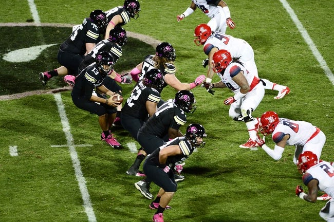 Oct 26, 2013; Boulder, CO, USA; Members of the Colorado Buffaloes and the Arizona Wildcats at the line of scrimmage during the the second quarter at Folsom Field. Mandatory Credit: Ron Chenoy-USA TODAY Sports