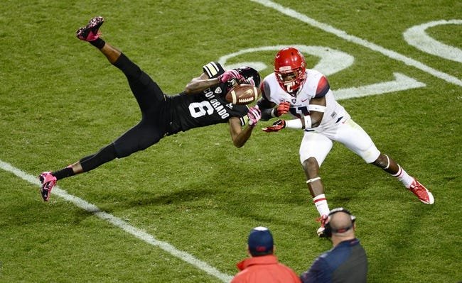 Oct 26, 2013; Boulder, CO, USA; Colorado Buffaloes wide receiver Paul Richardson (6) pulls in a reception as Arizona Wildcats safety William Parks (11) defends in the second quarter at Folsom Field. Mandatory Credit: Ron Chenoy-USA TODAY Sports