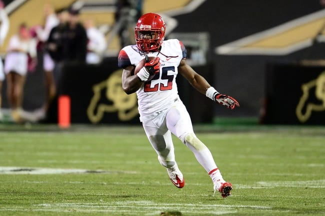 Oct 26, 2013; Boulder, CO, USA; Arizona Wildcats running back Ka'Deem Carey (25) carries for thirty yards on this play in the second quarter against the Colorado Buffaloes at Folsom Field. Mandatory Credit: Ron Chenoy-USA TODAY Sports