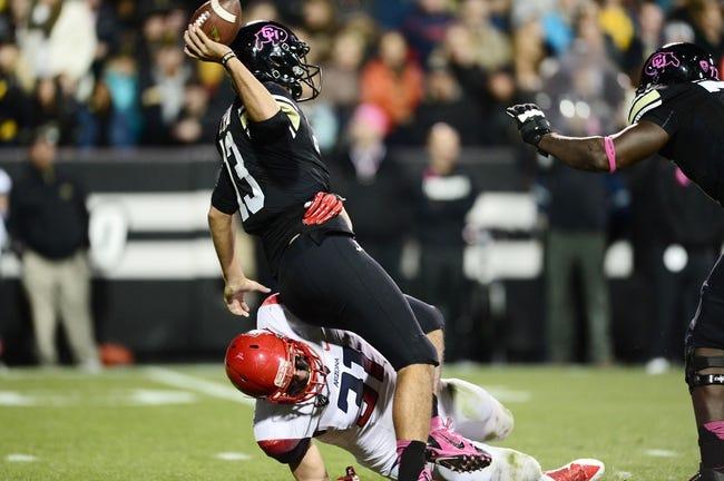 Oct 26, 2013; Boulder, CO, USA; Arizona Wildcats linebacker Scooby Wright (31) hurries Colorado Buffaloes quarterback Sefo Liufau (13) in the second quarter at Folsom Field. Mandatory Credit: Ron Chenoy-USA TODAY Sports