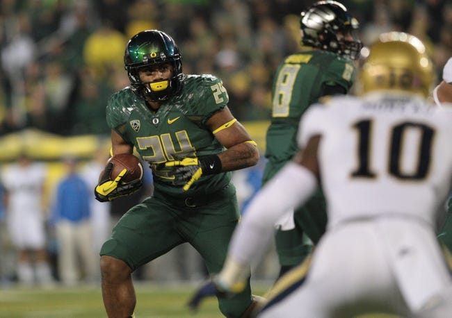 Oct 26, 2013; Eugene, OR, USA; Oregon Ducks running back Thomas Tyner (24) runs the ball in the second half against the UCLA Bruins at Autzen Stadium. Mandatory Credit: Scott Olmos-USA TODAY Sports