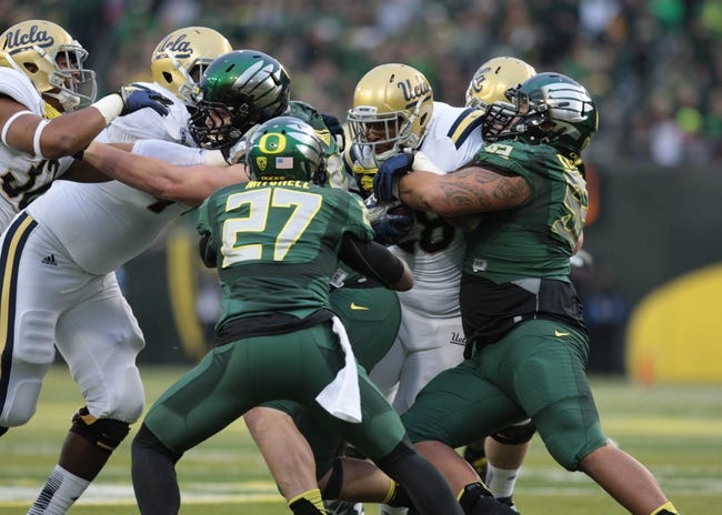 Oct 26, 2013; Eugene, OR, USA; UCLA Bruins running back Malcolm Jones (28) runs the ball against the UCLA Bruins at Autzen Stadium. Mandatory Credit: Scott Olmos-USA TODAY Sports