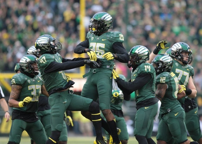 Oct 26, 2013; Eugene, OR, USA; Oregon Ducks linebacker Boseko Lokombo (25) intercepted the ball in the second half against the UCLA Bruins at Autzen Stadium. Mandatory Credit: Scott Olmos-USA TODAY Sports