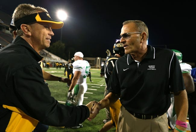 Oct 26, 2013; Hattiesburg, MS, USA; Southern Miss Golden Eagles head coach Todd Monken greets North Texas Mean Green head coach Dan McCarney at the end of their game at M.M. Roberts Stadium. North Texas won, 55-14. Mandatory Credit: Chuck Cook-USA TODAY Sports