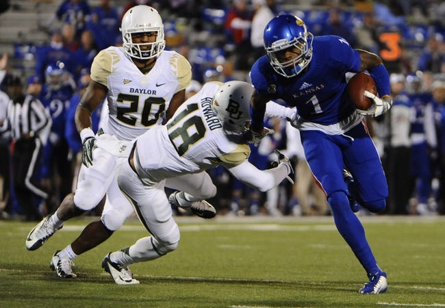 Oct 26, 2013; Lawrence, KS, USA; Kansas Jayhawks wide receiver Rodriguez Coleman (1) escapes the tackled of Baylor Bears cornerback Xavien Howard (18) in the second half at Memorial Stadium. Baylor won 59-14. Mandatory Credit: John Rieger-USA TODAY Sports