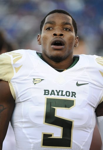 Oct 26, 2013; Lawrence, KS, USA; Baylor Bears wide receiver Antwan Goodley (5) stands on the sidelines against the Kansas Jayhawks in the second half at Memorial Stadium. Baylor won 59-14. Mandatory Credit: John Rieger-USA TODAY Sports