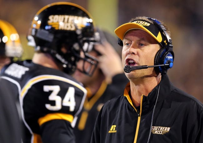 Oct 26, 2013; Hattiesburg, MS, USA; Southern Miss Golden Eagles head coach Todd Monken talks to a player in the second quarter against the North Texas Mean Green at M.M. Roberts Stadium. North Texas won 55-14. Mandatory Credit: Chuck Cook-USA TODAY Sports