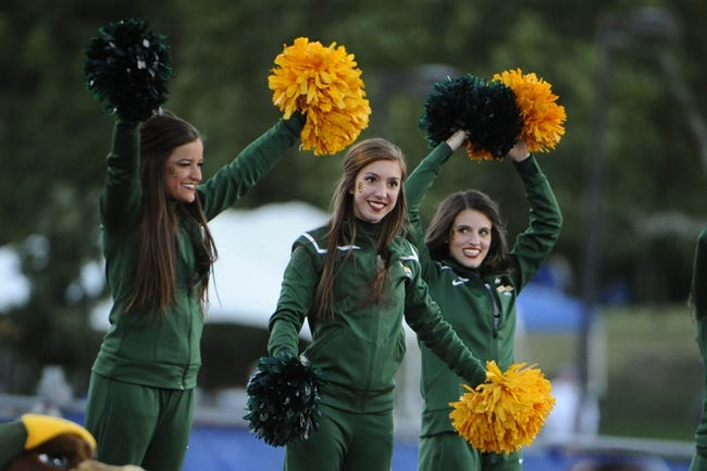 Oct 26, 2013; Lawrence, KS, USA; Baylor Bears cheerleaders perform against the Kansas Jayhawks in the second half at Memorial Stadium. Baylor won the game 59-14. Mandatory Credit: John Rieger-USA TODAY Sports