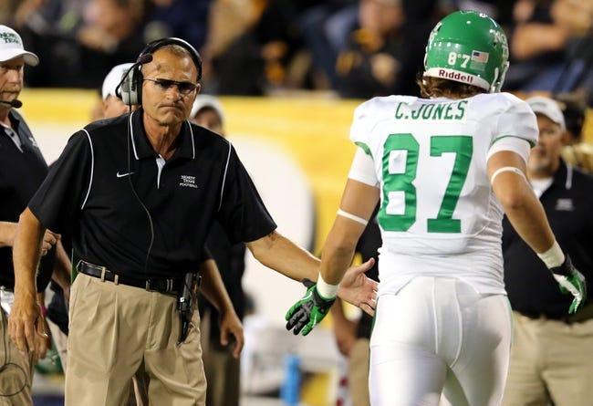 Oct 26, 2013; Hattiesburg, MS, USA; North Texas Mean Green head coach Dan McCarney greets tight end Cooper Jones (87) against the Southern Miss Golden Eagles in the first quarter at M.M. Roberts Stadium. North Texas won 55-14. Mandatory Credit: Chuck Cook-USA TODAY Sports