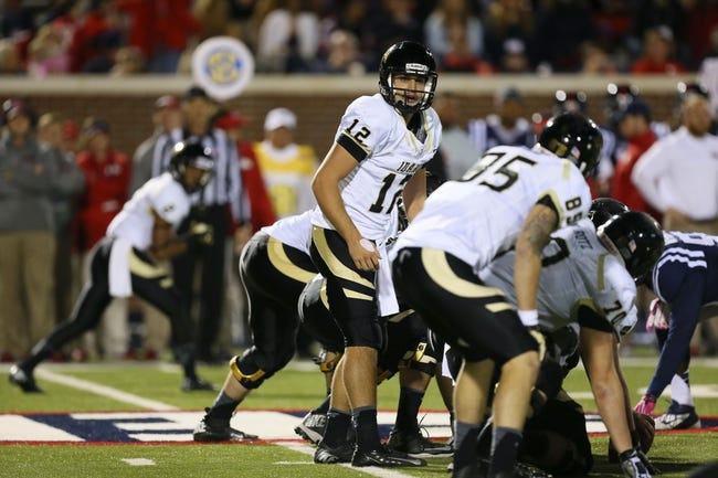 Oct 26, 2013; Oxford, MS, USA;  Idaho Vandals quarterback Taylor Davis (12) calls a play at the line during the game against the Mississippi Rebels at Vaught-Hemingway Stadium. Mississippi Rebels win the game against the Idaho Vandals with a score of 59-14.  Mandatory Credit: Spruce Derden-USA TODAY Sports