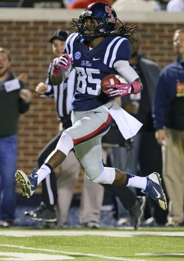 Oct 26, 2013; Oxford, MS, USA;  Mississippi Rebels wide receiver Ja-Mes Logan (85) runs the ball in for a touchdown during the game against the Idaho Vandals at Vaught-Hemingway Stadium. Mississippi Rebels win the game against the Idaho Vandals with a score of 59-14.  Mandatory Credit: Spruce Derden-USA TODAY Sports