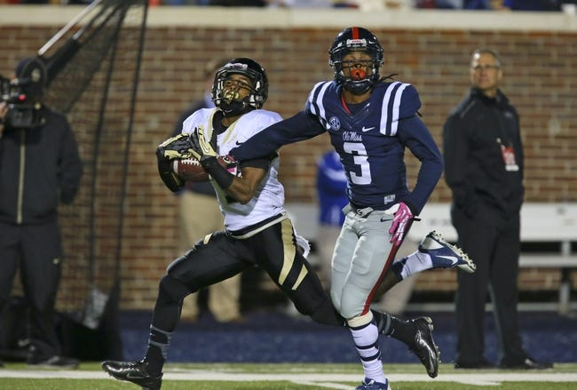 Oct 26, 2013; Oxford, MS, USA;  Idaho Vandals wide receiver Dezmon Epps (1) makes a reception while guarded by Mississippi Rebels defensive back Charles Sawyer (3) during the game at Vaught-Hemingway Stadium. Mississippi Rebels win the game against the Idaho Vandals with a score of 59-14.  Mandatory Credit: Spruce Derden-USA TODAY Sports