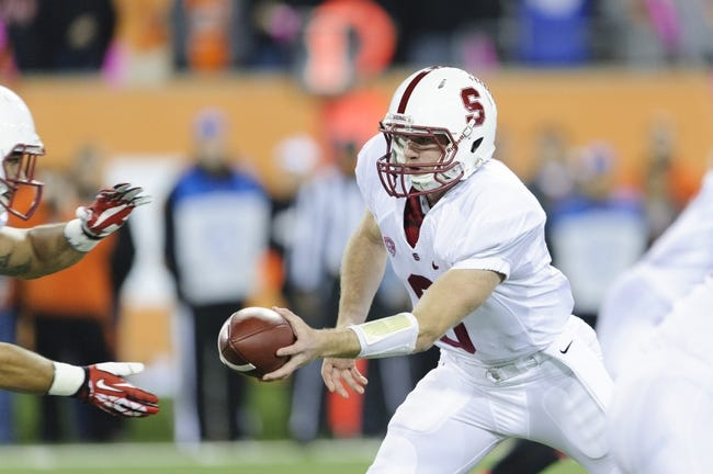 Oct 26, 2013; Corvallis, OR, USA; Stanford Cardinal quarterback Kevin Hogan (8) hands the ball off during the 1st half against the Oregon State Beavers at Reser Stadium. Mandatory Credit: Steven Bisig-USA TODAY Sports