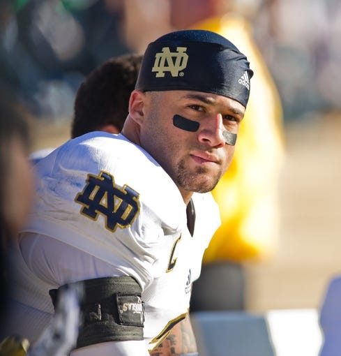 Oct 26, 2013; Colorado Springs, CO, USA; Notre Dame Fighting Irish cornerback Bennett Jackson (2) sits on the bench during the game against the Air Force Falcons at Falcon Stadium. Notre Dame won 45-10. Mandatory Credit: Matt Cashore-USA TODAY Sports