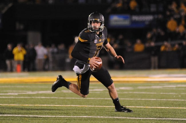 Oct 26, 2013; Columbia, MO, USA; Missouri Tigers quarterback Maty Mauk (7) runs with the ball during the second quarter against South Carolina at Faurot Field. South Carolina won 27-24. Mandatory Credit: Denny Medley-USA TODAY Sports