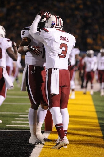 Oct 26, 2013; Columbia, MO, USA; South Carolina Gamecocks wide receiver Nick Jones (3) is congratulated by team mates after scoring a touchdown during the second quarter against the Missouri Tigers at Faurot Field. South Carolina won 27-24. Mandatory Credit: Denny Medley-USA TODAY Sports