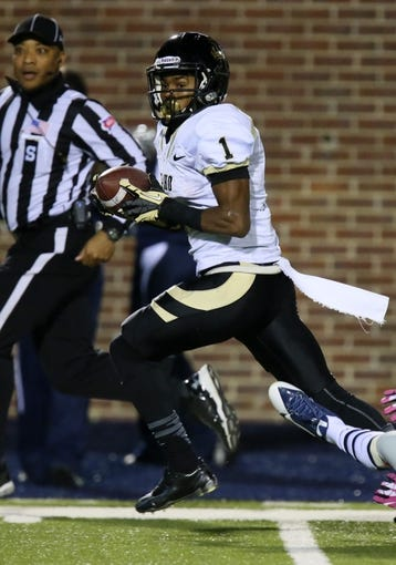 Oct 26, 2013; Oxford, MS, USA;  Idaho Vandals wide receiver Dezmon Epps (1) advances the ball during the game against the Mississippi Rebels at Vaught-Hemingway Stadium. Mississippi Rebels win the game against the Idaho Vandals with a score of 59-14.  Mandatory Credit: Spruce Derden-USA TODAY Sports