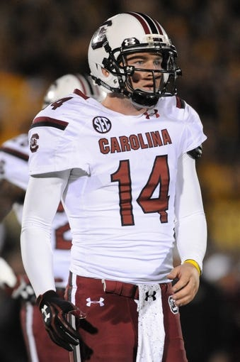 Oct 26, 2013; Columbia, MO, USA; South Carolina Gamecocks quarterback Connor Shaw (14) watches form the sidelines during the second half against the Missouri Tigers at Faurot Field. South Carolina won 27-24. Mandatory Credit: Denny Medley-USA TODAY Sports