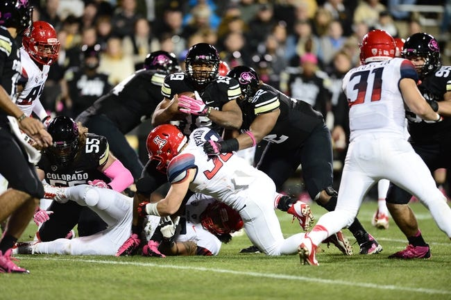 Oct 26, 2013; Boulder, CO, USA; Arizona Wildcats linebacker DeAndre' Miller (32) stops Colorado Buffaloes running back Michael Adkins II (19) in the second quarter at Folsom Field. Mandatory Credit: Ron Chenoy-USA TODAY Sports