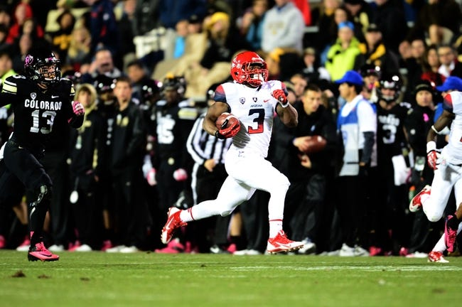 Oct 26, 2013; Boulder, CO, USA; Arizona Wildcats running back Daniel Jenkins (3) runs with the ball in the fourth quarter against the Colorado Buffaloes at Folsom Field. The Wildcats defeated the Buffaloes 44-20. Mandatory Credit: Ron Chenoy-USA TODAY Sports