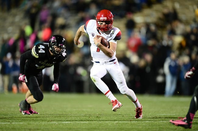 Oct 26, 2013; Boulder, CO, USA; Arizona Wildcats quarterback B.J. Denker (7) scrambles with the football in the third quarter against the Colorado Buffaloes at Folsom Field. The Wildcats defeated the Buffaloes 44-20. Mandatory Credit: Ron Chenoy-USA TODAY Sports
