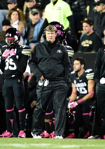 Oct 26, 2013; Boulder, CO, USA; Colorado Buffaloes head coach Mike Macintyre walks his sidelines in the fourth quarter against the Arizona Wildcats at Folsom Field. The Wildcats defeated the Buffaloes 44-20. Mandatory Credit: Ron Chenoy-USA TODAY Sports