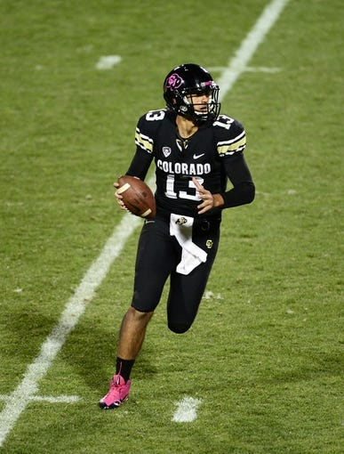 Oct 26, 2013; Boulder, CO, USA; Colorado Buffaloes quarterback Sefo Liufau (13) looks to pass in the third quarter against the Colorado Buffaloes at Folsom Field. The Wildcats defeated the Buffaloes 44-20. Mandatory Credit: Ron Chenoy-USA TODAY Sports