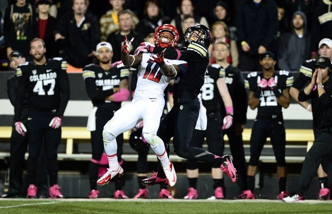 Oct 26, 2013; Boulder, CO, USA; Colorado Buffaloes defensive back Parker Orms (13) pass interferes on Arizona Wildcats wide receiver Samajie Grant (10) in the second quarter at Folsom Field. Mandatory Credit: Ron Chenoy-USA TODAY Sports
