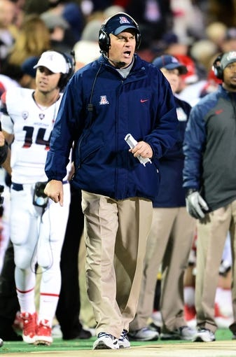 Oct 26, 2013; Boulder, CO, USA; Arizona Wildcats head coach Rich Rodgriguez walks the sidelines in the third quarter against the Colorado Buffaloes at Folsom Field. The Wildcats won 44-20. Mandatory Credit: Ron Chenoy-USA TODAY Sports