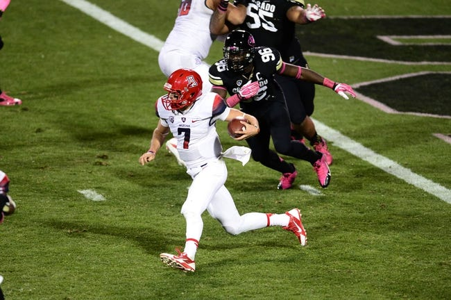 Oct 26, 2013; Boulder, CO, USA; Arizona Wildcats quarterback B.J. Denker (7) runs with the ball in the third quarter against the Colorado Buffaloes at Folsom Field. The Wildcats won 44-20. Mandatory Credit: Ron Chenoy-USA TODAY Sports
