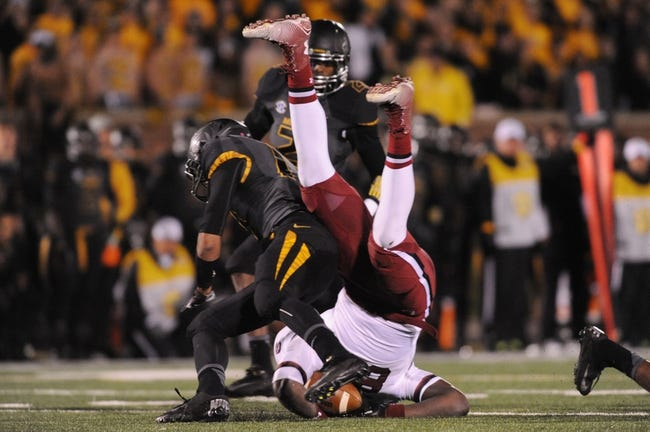 Oct 26, 2013; Columbia, MO, USA; South Carolina Gamecocks tight end Jerell Adams (89) is tackled by Missouri Tigers safety Matt White (17) during the second half at Faurot Field. South Carolina won 27-24. Mandatory Credit: Denny Medley-USA TODAY Sports