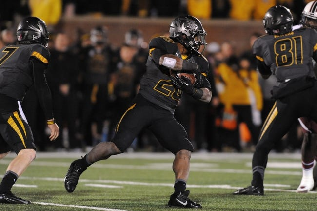 Oct 26, 2013; Columbia, MO, USA; Missouri Tigers running back Henry Josey (20) runs with the ball during the second half against the South Carolina Gamecocks at Faurot Field. South Carolina won 27-24. Mandatory Credit: Denny Medley-USA TODAY Sports