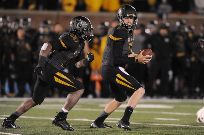Oct 26, 2013; Columbia, MO, USA; Missouri Tigers quarterback Maty Mauk (7) hands the ball off to running back Henry Josey (20) during the second half against the South Carolina Gamecocks at Faurot Field. South Carolina won 27-24. Mandatory Credit: Denny Medley-USA TODAY Sports