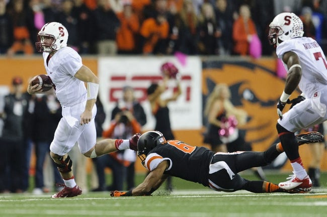 Oct 26, 2013; Corvallis, OR, USA; Stanford Cardinal quarterback Kevin Hogan (8) runs with the ball against the Oregon State Beavers during the first half at Reser Stadium. Mandatory Credit: Steven Bisig-USA TODAY Sports