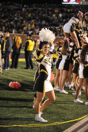 Oct 26, 2013; Columbia, MO, USA; Missouri Tigers cheerleaders perform for the crowd during the second half of the game against the South Carolina Gamecocks at Faurot Field. South Carolina won 27-24. Mandatory Credit: Denny Medley-USA TODAY Sports