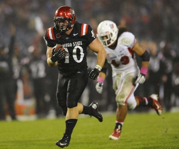 Oct 26, 2013; San Diego, CA, USA; San Diego State fullback Chad Young (40) runs for a touchdown to tie the game during the second half against the Fresno State Bulldogs at Qualcomm Stadium. Mandatory Credit: Christopher Hanewinckel-USA TODAY Sports