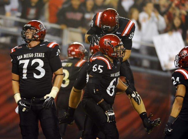 Oct 26, 2013; San Diego, CA, USA; San Diego State players celebrate after a touchdown to tie the game during the second half against the Fresno State Bulldogs at Qualcomm Stadium. Mandatory Credit: Christopher Hanewinckel-USA TODAY Sports