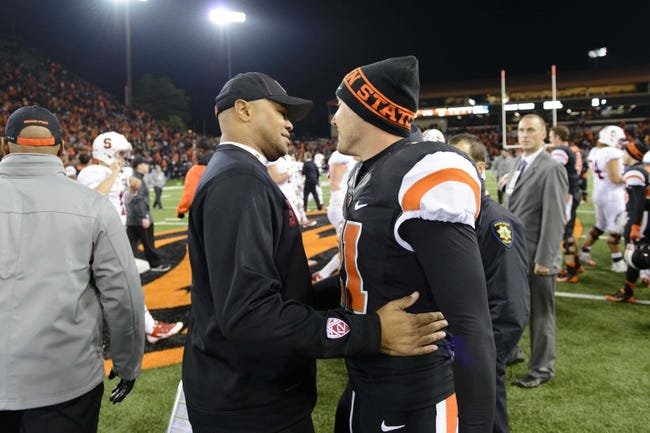 Oct 26, 2013; Corvallis, OR, USA; Stanford Cardinal head coach David Shaw hugs Oregon State Beavers wide receiver Mitch Singler (21) after the game at Reser Stadium. Stanford defeated Oregon State 20-12. Mandatory Credit: Steven Bisig-USA TODAY Sports