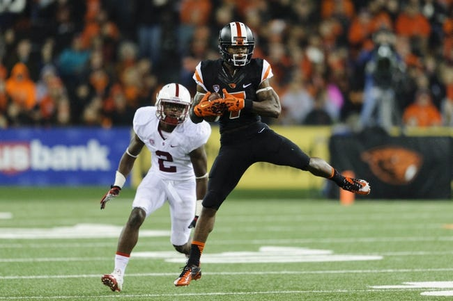Oct 26, 2013; Corvallis, OR, USA; Oregon State Beavers wide receiver Brandin Cooks (7) catches a pass while being covered by Stanford Cardinal cornerback Wayne Lyons (2) during the 2nd half at Reser Stadium. Stanford defeated Oregon State 20-12. Mandatory Credit: Steven Bisig-USA TODAY Sports