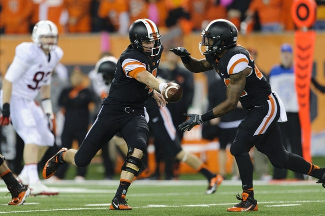 Oct 26, 2013; Corvallis, OR, USA; Oregon State Beavers quarterback Sean Mannion (4) hands the ball off to running back Storm Woods (24) during the 2nd half against the Stanford Cardinal at Reser Stadium. Stanford defeated Oregon State 20-12. Mandatory Credit: Steven Bisig-USA TODAY Sports