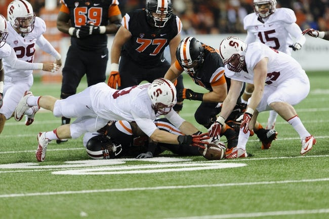 Oct 26, 2013; Corvallis, OR, USA; Stanford Cardinal linebacker Trent Murphy (93) dives for the loose fumbled ball during the 2nd half against the Oregon State Beavers at Reser Stadium. Stanford defeated Oregon State 20-12. Mandatory Credit: Steven Bisig-USA TODAY Sports