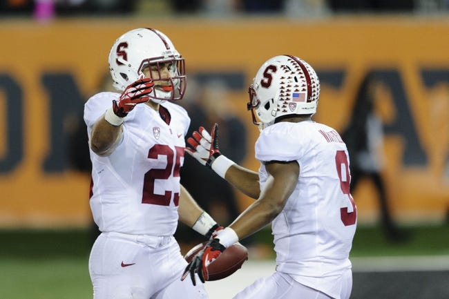 Oct 26, 2013; Corvallis, OR, USA; Stanford Cardinal running back Tyler Gaffney (25) and wide receiver Kodi Whitfield (9) celebrate after Gaffney ran the ball in for a touchdown against the Oregon State Beavers during the 2nd half at Reser Stadium. Stanford defeated Oregon State 20-12. Mandatory Credit: Steven Bisig-USA TODAY Sports