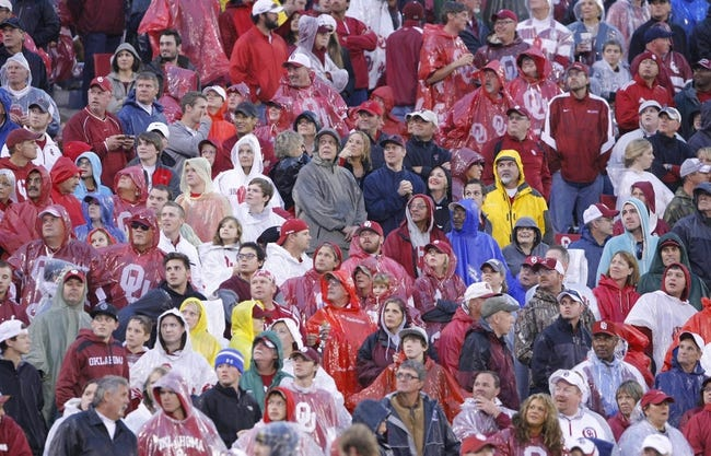 Oct 26, 2013; Norman, OK, USA; Oklahoma Sooner fans watch a replay on the scoreboard during the game against the Texas Tech Red Raiders at Gaylord Family - Oklahoma Memorial Stadium. Oklahoma won 38-30.  Mandatory Credit: Alonzo Adams-USA TODAY Sports