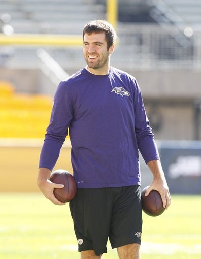 Oct 20, 2013; Pittsburgh, PA, USA; Baltimore Ravens quarterback Joe Flacco (5) reacts on the field before playing the Pittsburgh Steelers at Heinz Field. The Steelers won 19-16. Mandatory Credit: Charles LeClaire-USA TODAY Sports
