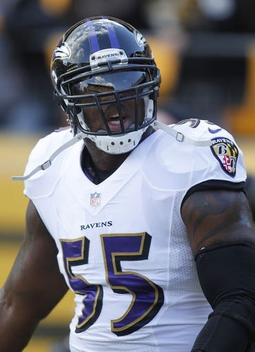 Oct 20, 2013; Pittsburgh, PA, USA; Baltimore Ravens outside linebacker Terrell Suggs (55) reacts to Pittsburgh Steelers fans during warm-ups before playing the Steelers at Heinz Field. The Steelers won 19-16. Mandatory Credit: Charles LeClaire-USA TODAY Sports