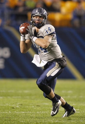 Oct 19, 2013; Pittsburgh, PA, USA; Old Dominion Monarchs quarterback Taylor Heinicke (14) rolls out of the pocket and looks to pass against the Pittsburgh Panthers during the first quarter at Heinz Field. Pittsburgh won 35-24. Mandatory Credit: Charles LeClaire-USA TODAY Sports