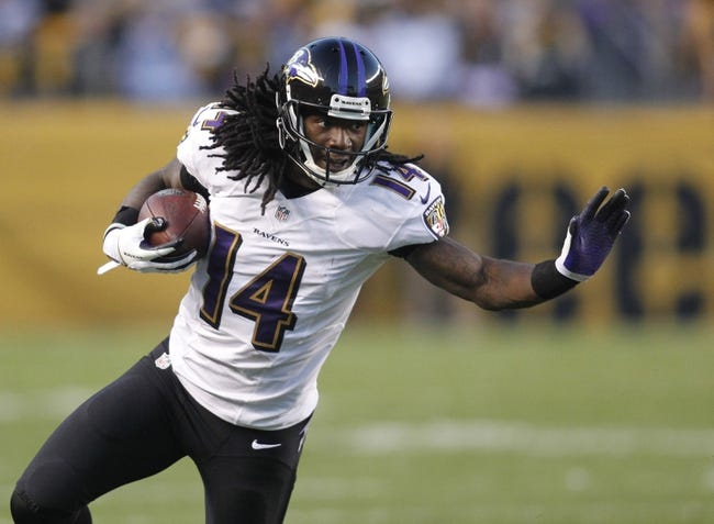 Oct 20, 2013; Pittsburgh, PA, USA; Baltimore Ravens wide receiver Marlon Brown (14) runs after a pass reception against the Pittsburgh Steelers during the third quarter at Heinz Field. The Steelers won 19-16. Mandatory Credit: Charles LeClaire-USA TODAY Sports