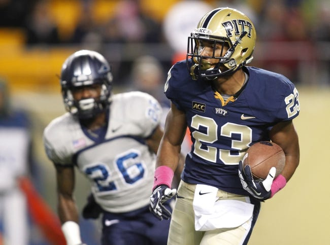Oct 19, 2013; Pittsburgh, PA, USA; Pittsburgh Panthers wide receiver Tyler Boyd (23) returns a kick-off against the Old Dominion Monarchs during the first quarter at Heinz Field.  Pittsburgh won 35-24. Mandatory Credit: Charles LeClaire-USA TODAY Sports